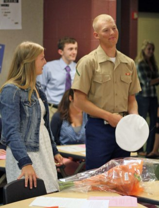 U.S. Marine James Tompkins, 19, of Prospect, surprised his Lauren, 17, by visiting her Sept. 26 at Woodland Regional High School in Beacon Falls. James Tompkins recently completed military occupancy school and will be deployed to Afghanistan in December. –ELIO GUGLIOTTI