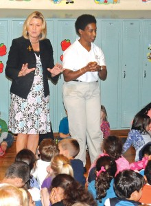 """Salem Elementary School Principal Jennifer Kruge, left, and Special Olympic medalist Loretta Claiborne address students at the school in Naugatuck on Oct. 9. Claiborne visited Salem and Naugatuck High School to talk with students as part of the high school DECA group's """"Spread the Word to Stop the Word"""" campaign. -LUKE MARSHALL"""