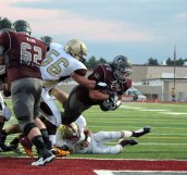 Naugatuck senior lineman Mark Cavagnulo (77) plunges into the end zone for a 1-yard touchdown Sept. 26 at home versus Sacred Heart. Naugatuck won the game, 49-19. –ELIO GUGLIOTTI