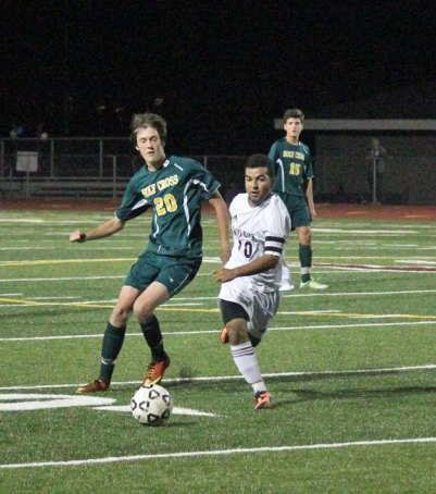 Naugatuck's Ygor Silva (10) weaves his way around Pat Budris (20) of Holy Cross as he moves the ball up field Oct. 17 in Naugatuck. The Greyhounds won the game, 2-0, and capped a perfect regular season with a 1-0 victory over Wilby Monday night. –ELIO GUGLIOTTI