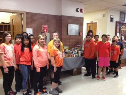 Naugatuck public schools and the Board of Education office participated in the GO ORANGE campaign Sept. 25 as part of No Kid Hungry Month. Students and staff showed their support by wearing orange clothing, tying orange ribbons on trees, decorating classrooms or doors in orange and holding food drives. Thousands of non-perishable food items were collected and donated to the Naugatuck Ecumenical Food Bank. Pictured: Hillside Intermediate School Principal Johnna Hunt and students pose with food donations collected as part of the GO ORANGE campaign. –CONTRIBUTED