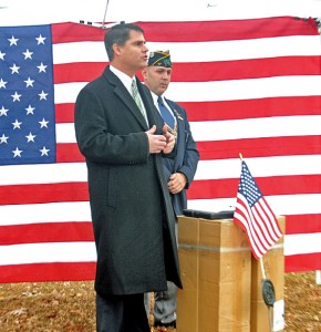 Naugatuck Mayor Robert Mezzo, left, talks to the crowd during a ceremony last Friday at St. James Cemetery in Naugatuck to recognize those who donated to help pay to replace American flags meant for the graves of veterans that were stolen Nov. 9 from the cemetery as Naugatuck Veterans Council Chairman John DeBisschop looks on. More than $3,000, including four boxes of flags, was donated to the council following the theft, according to DeBisschop. –LUKE MARSHALL