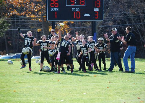 The Woodland Jr. Hawks celebrate after winning the Orange Bowl 33-13 over Aspetuck Nov. 2 in Prospect. The team is comprised of fourth- and fifth-graders. –CONTRIBUTED