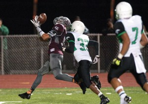 Naugatuck's Bryan Coney (19) pulls in a 49-yard touchdown reception in front of Wilby's Jayson Chavis (33) during their game Nov. 1 at Naugatuck High School. The Greyhounds won the game, 42-14. –RA ARCHIVE