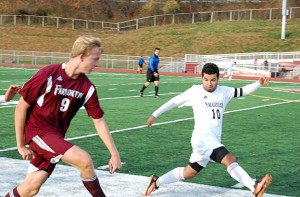 Naugatuck's Ygor Silva (10) battles Farmington Matt Sroka (9) for possession along the sideline Nov. 9 during the Class L tournament quarterfinal in Naugatuck. The Greyhounds fell in overtime, 2-1, to Farmingto. –KEN MORSE