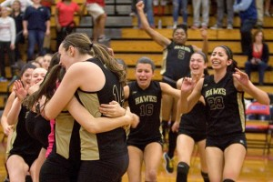 Woodland volleyball players celebrate after beating Foran High 3-1 to win the Class M championship at Berlin High in Berlin Nov. 16. –RA ARCHIVE