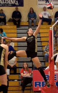 Woodland's Brianna Pacileo goes for the kill against Foran High during the CIAC Class M championship at Berlin High in Berlin Saturday. Woodland won, 3-1, and Pacileo was named MVP of the tournament. –RA ARCHIVE