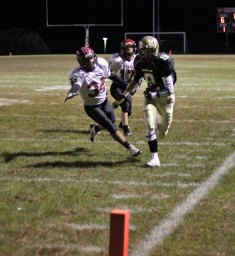 Woodland's Mike Kenney (9) races for the goal line as Torrington's Damian Lajoie (34) and Nathan Manchester (17) give chase Nov. 8 in Beacon Falls. The Hawks won the game, 46-14. –ELIO GUGLIOTTI