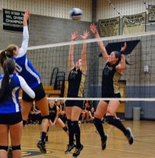 Woodland's Abbey Rosato (14) and Brianna Pacileo (15) go up to defend at the net versus Tolland in Beacon Falls in the quarterfinal round of the Class M tournament Nov. 8. The Hawks won, 3-2. –KEN MORSE