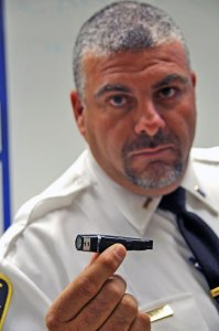 Naugatuck police Lt. Bryan Cammarata holds up one of the body cameras borough officers are now wearing. –LUKE MARSHALL