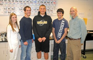Woodland Regional High School's physics team, from left, Alexa Kiernan, JD Dyckman, Jake Boncal, and Jake Mancini, along with their advisor, science teacher Mark Mierzejewski, took first place in the Vector Sedition event at the Yale Physics Olympics Oct. 19 at Yale University in New Haven. It was the first win for Woodland's team at the Olympics. –LUKE MARSHALL