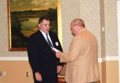 Hob Brook Golf Course Golf Pro Bob Clark, left, was elected to a three-year term as a director on the Connecticut State Golf Association Board of Directors Nov. 18 during the Connecticut Section's 80th annual fall meeting in North Stonington. –CONTRIBUTED