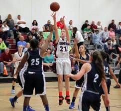 Naugatuck's Nicole Boucher (21) shoots surrounded by Ansonia defenders Dec. 20 at Naugatuck High. Boucher scored 14 points and added 10 rebounds as the Greyhounds beat the Chargers, 49-27. –ELIO GUGLIOTTI