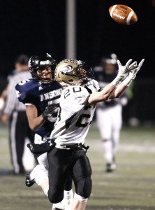 Woodland's Joe Poeta makes the catch as Ansonia's Tyler Bailey gives chase during the Class S championship game Dec. 13 at Central Connecticut State University in New Britain. Ansonia won the game, 51-12.