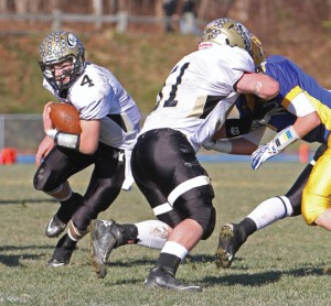 Woodland's Sean McAllen (4) follows a block by teammate Will Flormann (51) Nov. 29 versus Seymour at Seymour High School. The Hawks defeated the Wildcats, 22-19. -RA ARCHIVE
