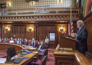 State Sen. Joseph J. Crisco, Jr. (D-17), chair of the General Assembly's Internship Committee, welcomes new legislative interns last month as they begin their orientation program in the state Senate chamber. -CONTRIBUTED
