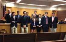 Prospect resident Lukas Fedak, a junior at Chase Collegiate School in Waterbury, (pictured last on the right in the front row) is a member of the school's mock trial team, which competed against 68 teams at the statewide mock trial competition Dec. 2 in Danbury Superior Court. Similar to a real trial, the teams must prepare and deliver opening statements, direct examinations of their own witnesses, cross examinations of the opposing teams' witnesses and closing arguments. –CONTRIBUTED