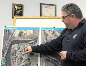 Beacon Falls Park Commissioner Joe Rodorigo points out a piece of property near Riverbend Park that is privately owned during the Board of Selectmen meeting Monday night. The town is hoping it can obtain two private properties as part of improvements to the park on Nancy Avenue by forgiving back taxes on both properties. –LUKE MARSHALL