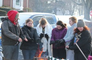 Prospect Congregational Church Senior Youth Fellowship members, from left, Mike Normand, 15, Ariana Sherwood, 14, Kaitlyn Dirga, 16, Nicole Lukeski, 15, Brianna Hudson, 15, and Kayla Rielly, 17, warm themselves by the fire Jan. 19 on the traffic island at the intersections of Routes 69 and 68 in Prospect during the fellowship's 13th annual Homeless Awareness Sleepout. Ten members of the group spent 24 hours living on the traffic island to raise awareness for homelessness and funds for the Greater Waterbury Interfaith Ministries and Brass City Harvest. –ELIO GUGLIOTTI