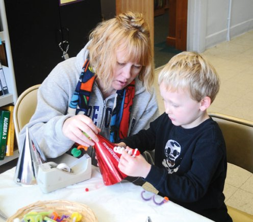 The Beacon Falls Public Library hosted a New Year's Eve party hat craft program Dec. 27 at which children were able to create festive hats to help them ring in the New Year. -LUKE MARSHALL
