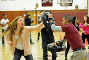 Naugatuck High School junior Megan Warnke, left, works on the basics of Filipino Kung Tao with physical education teacher Anthony Loomis Jan. 24 during class. Loomis was named the 2014 Northeast region high school physical education teacher of the year by the Society of Health and Physical Educators of America. –LUKE MARSHALL