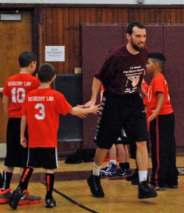 Naugatuck High graduate Mike Wilson, who coaches the NHS boys basketball team, is introduced before the first Josh Ruccio Scholarship basketball game Jan. 4 at the high school. Wilson played for the Old School. –KEN MORSE