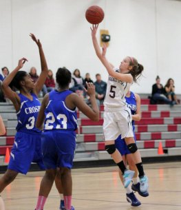 Naugatuck's Jessica Butler (5) shoots a runner over Crosby's Cierra parchment (23) and Destin Trammell (30) Jan. 28 in Naugatuck. Naugy won the game, 37-29. –ELIO GUGLIOTTI