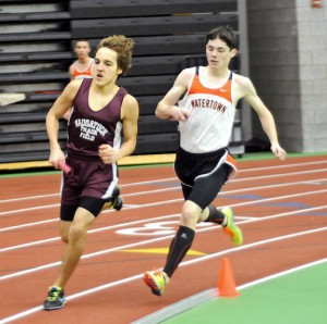 Naugatuck's Mark Zamani and Watertown's Seamus Rafferty battle during their leg of the 4-by-800-meter relay at the NVL indoor boys and girls track championships Jan. 28 at the Floyd Little Athletic Center at Hillhouse High School in New Haven. The Naugatuck boys came in sixth at the meet. –LUKE MARSHALL