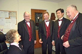 A quartet from the Coastal Chordsmen Chorus, from left, Jim Farrell of Bridgeport, Vic Lembo of Beacon Falls, Dave Huang of Cheshire and Russ Lang of Seymour serenades Margaret Berthelson of Trumbull as part of the chorus' Singing Valentines. The chorus will once again be offering Singing Valentines Feb. 14 from 8 a.m. to 8 p.m. in Fairfield and New Haven Counties. A loved one will receive a song plus a card, chocolate lollipop and rose for $65, $90 for a dozen roses. For more information or to order a Singing Valentine call (203) 816-0462 or visit www.coastalchordsmen.org/valentines.html. –CONTRIBUTED