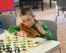 A youth plays chess at the Prospect Library Feb. 24. The library is hosting a chess practice program for students in second grade through 12th grade every Monday through March 31. –LUKE MARSHALL