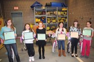 The Naugatuck Fire Department recognized the winners of the 8th annual Connecticut Fire Prevention Poster Contest Feb. 20 at fire headquarters. The contest was open to all Naugatuck students in fourth and fifth grade. The top three winners in both grades received bicycles, which were donated by Walmart. Pictured, from left, fifth-grader Alysha Bucci-Lasalle, fourth-grader Mykaila Meunier, fourth-grader Ella Generali, fourth-grader Zoe McCasland, fifth-grader Kylie Hinman and fifth-grader Rosemary Hall. –LUKE MARSHALL