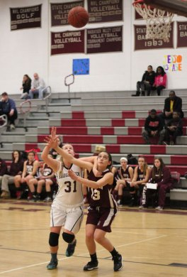 Naugatuck's Christina Jando (31) battles for position with Torrington's Brie Pergola (13) for a rebound Feb. 20 in Naugatuck. Naugy fell to Torrington, 52-36. –ELIO GUGLIOTTI