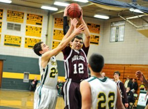 Naugatuck's Ryne Griesenauer (12) is averaging 14.4 points and close to double digit rebounds per game for the Greyhounds this season. As the only senior in Naugy's lineup, Griesenauer, a captain, is leading the way by example. –FILE PHOTO