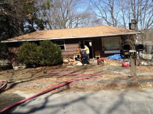 Fire investigators work to determine what caused a fire at this two-family house in Naugatuck on Thursday. Nobody was injured, and the fire remains under investigation. –RA ARCHIVE