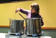 Tess Szamatulski stirs a pot containing the grains and sugars that will ultimately become a clone of Sierra Nevada's Stout beer during a craft beer making and tasting event at the Whittemore Library in Naugatuck March 5. Mark and Tess Szamatulski, who own Maltose Express, a home brewing and wine making supply store in Monroe, came to the library to give a class on making beer. –LUKE MARSHALL