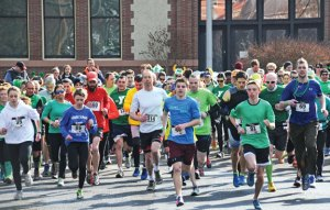 Runners take off for a 10K run during the Ion Bank St. Patrick's Day Road Race and Festival Saturday in downtown Naugatuck. –LUKE MARSHALL