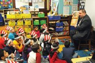 Naugatuck Assistant Superintendent of Schools Christopher Montini reads 'Tops and Bottoms,' by Janet Stevens to second graders in Debby Wilson's class at Salem Elementary School March 7. Montini, along with other guest readers, were at the school to celebrate Read Across America, which honors Dr. Seuss' birthday and encourages children to read. –LUKE MARSHALL