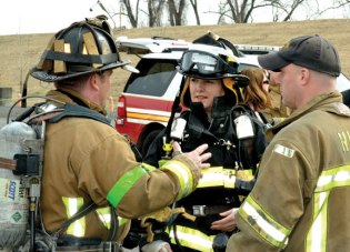 State Rep. Lezlye Zupkus (R-89), center, participated in Fire Ops 101 on April 7 in Hartford. The program provides hands-on experience and information about firefighting. Zupkus suited up for an exercise that simulated the rigors of tackling a fire-related emergency. –CONTRIBUTED