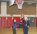 Maple Hill School first-grade teacher Jodie Ruccio, left, who also coaches the Naugatuck High School girls basketball team, gives students some pointers with the assistance of Maple Hill School Principal Cheryl Kane during the Hoops and Homework program at the school in Naugatuck April 8. The program, which Ruccio developed, is designed to help the first- through fourth-graders at Maple Hill School to become better at basketball while enforcing good study habits by being successful in their homework assignments. –KEN MORSE