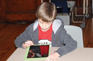 Salem Elementary School second-grader Daniel Anderson works on a video on an iPad March 28 during the book talk club at the school in Naugatuck. –LUKE MARSHALL