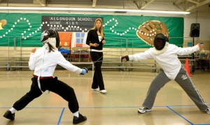 Sandra Marchant of Prospect, center, judges a bout in 2010 between Ty Wilmot, left, and  Jacob DeGoes during her beginners fencing class at Algonquin School in Prospect. Marchant won the North American Cup (NAC) championship in the Vet 40 division this month and is the No. 1 ranked female fencer age 40 and over in the nation. –RA ARCHIVE