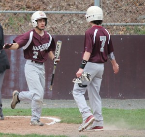 Naugatuck's Josh Aviles (3) is congratulated by teammate Kyle Plasky (7) after scoring a run April 14 versus Kennedy at Rotary Field in Naugatuck. The Greyhounds beat the Eagles, 8-3. After losing their first game, Naugy has rattled off five straight wins. –ELIO GUGLIOTTI