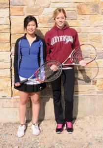 Naugatuck High seniors and girls tennis captains Hannah Kim, left, and Kayla Gallant will lead an experienced team on the court this season. –LUKE MARSHALL