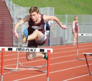 Naugatuck's Brian Reilly clears a hurdle May 13 during a meet against Wilby and Crosby in Naugatuck. The Naugatuck boys and girls teams won the meet. –LUKE MARSHALL