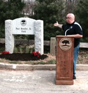 Rob Bendler speaks during a May 3 ceremony dedicating the Fawn Meadow Field in Naugatuck to his father, the late Paul Bendler Sr. The Parks Commission dedicated the field and will dedicate two more fields this month to former mayors Joan Taf and the late Robert Paolino. –CONTRIBUTED