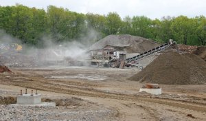 Rock is being ground up at the construction site of the new Prospect Elementary School on New Haven Road in Prospect May 23. The rocks taken from the site will be used in the project. –ELIO GUGLIOTTI