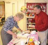 Naugatuck Senior Center volunteer Carole Mancini, left, cuts pieces of cake to serve during a game of Bingo May 9 at the center with help from Senior Center Director Harvey Frydman. Mancini, who has volunteered at the center for 44 years, was recognized for her dedicated service and presented with a grocery gift card by Daniel Buffington of New Opportunities, Inc. –LUKE MARSHALL