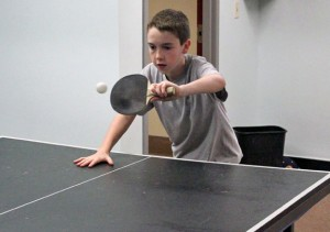 Aaron Lapham, 12, of Naugatuck plays a game of ping pong in the newly redesigned youth room at the Naugatuck YMCA May 15. –ELIO GUGLIOTTI