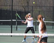 Woodland's Lauren Thompkins returns a shot as her doubles partner Erica Boccuzzi watches May 5 versus Kennedy in Beacon Falls. The duo won their match 8-2, as the Hawks defeated the Eagles 6-1. –ELIO GUGLIOTTI