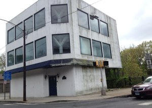The former commercial building at 1 South Main St. in Naugatuck is among four buildings in the borough that will be demolished after the 2014-15 fiscal year begins. –RA ARCHIVE
